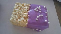 Sofia the first treat. Rice krispies dipped in colored chocolate, sprinkled with candy pearls.