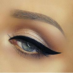 Light bright glittery smokey eye defined catflick with lightly defined brows