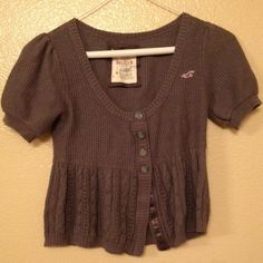 Hollister Sweater Top This grey top has four buttons in the front and fits like a crop top. Hollister Tops