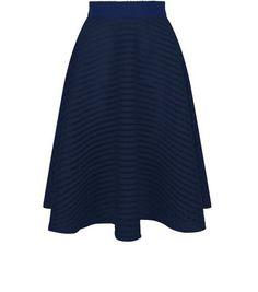 Jupe mi-longue bleue marine à rayures en tulle