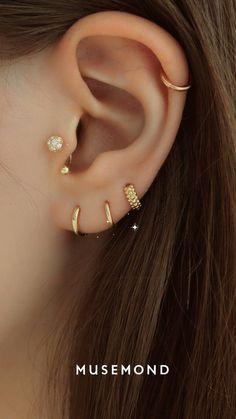 14K gold dainty piercings and huggie hoop earrings for ear stack goals! #earstacks #curatedear #earrings #piercings #earstack #earpiercings Ear Piercing For Women, Unique Ear Piercings, Cute Piercings, Multiple Ear Piercings, Cute Cartilage Earrings, Tragus Piercing Earrings, Ear Piercings Cartilage, Women's Earrings, Gold Earrings Designs