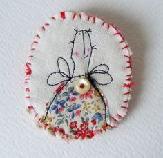 Handmade BROOCH .. machine embroidered with super duper bright and shiny button