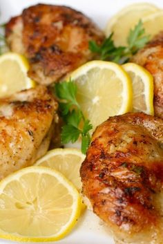 Lemon Chicken * 2 tbsp. lemon zest  1/3 cup freshly squeezed lemon juice  2 cloves garlic, crushed  2 tsp. fresh thyme leaves  1 tsp. fresh rosemary leaves, finely minced  1 tsp. salt  1 tsp. black pepper  1-2 kgs. of bone-in, skin-on chicken thighs or drumsticks  2-3 tbsp. melted butter  Thinly sliced lemons, for garnish