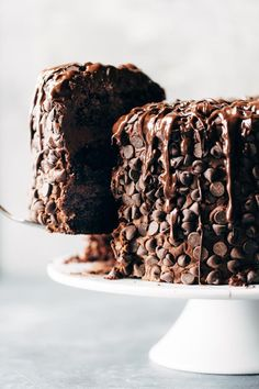 This is the cake for chocolate lovers! Ultramoist chocolate cake, layers of cream cheese chocolate frosting, and an awesome chocolate chip + chocolate drizzle exterior. Recipe based off of this solid Chocolate Blackout Cake from Life Made Simple. Matilda Chocolate Cake, Too Much Chocolate Cake, Beattys Chocolate Cake, Best Chocolate, Delicious Chocolate, Chocolate Lovers, Chocolate Desserts, Chocolate Cream, Chocolate Drizzle