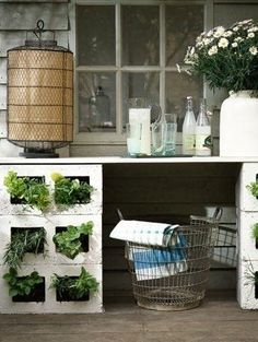 Stash peek-a-boo plants in your cinder blocks. | 36 Genius Ways To Hide The Eyesores In Your Home