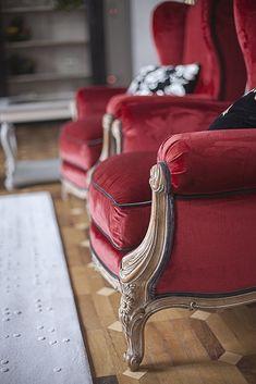 Red silk velvet detail on 8010 armchair