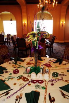 At our recent Awards Banquet we went with a Mardi Gras theme.  These fun centerpieces were cheaply (and easily) made from stuff we found at the party store - beads, masks, feathers.