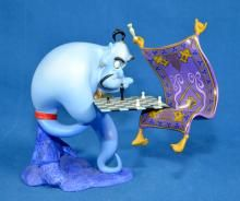 WDCC ALADDIN ''I'M LOSING TO A RUG'' GENIE & MAGIC CARPET #5615/12,500 W/ BOX AND COA - Box measures: 10.5''H x 15''W x 14''D - Condition: Age appropriate wear; All items sold as is.