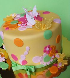 Yellow cake with butterflies by bubolinkata, via Flickr. For the girl's birthday.