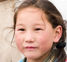 Mongolian girl. I really like Mongolian's face, their small eyes always look wild, white skin with the cheekbones turn pink because of cold, beautiful hair and natural smile :)