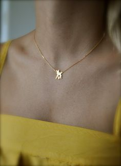 Deer Bambi by maldemer on Etsy, $22.00 so danty and pretty. Look its Bambi on a necklace :)