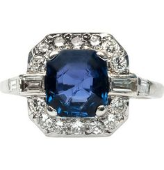 Stunning Art Deco Diamond Sapphire Ring.  Shadow Creek is a sophisticated Art Deco platinum ring centering a natural square step cut sapphire gauged at 2.35cts and accompanied with a Guild Laboratories Certificate stating the sapphire is of Thailand origin and heat treated.