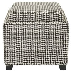 A versatile addition to any room, this classic storage ottoman features a reversible tray top and eye-catching houndstooth upholstery.