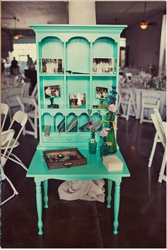 cool idea- take a hutch- put it on an old table-makes a great colorful desk/work area for a small room-or in a hallway