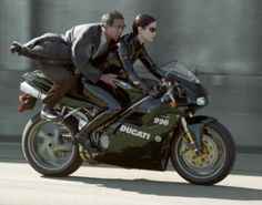 Trinity's Ducati 996 from the Matrix, not a naked bike but still very cool :-P Ducati 996, Ducati Motorcycles, Yamaha, Trinity Matrix, Cyberpunk, Motos Vintage, The Matrix Movie, Matrix Reloaded, Carrie Anne Moss