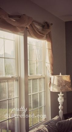 Country Decorating Style in a Farmhouse Family Room - Curtain swags made from landscape burlap. Description from pinterest.com. I searched for this on bing.com/images