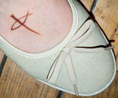 very cool cross tattoo...