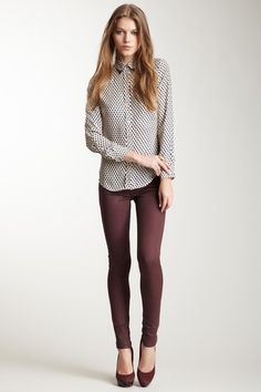 burgundy skinny jeans + button-up printed blouse.