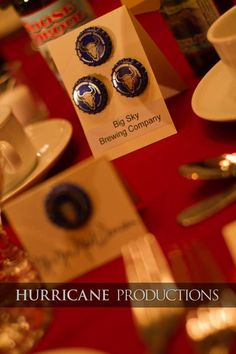 Beer themed wedding uses bottle caps and breweries as the table numbers.