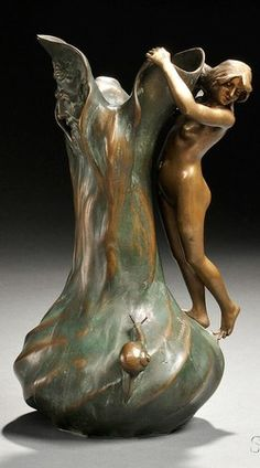 decorative accessories, France, An Art Nouveau, S. Domenech vase, bronze, Paris, France, late 19th to early 20th century, decorated with a nude figure and snail on naturalistic plant-form body with a face on the opposing side, signed S. Domenech and foundry mark Bronze Garanti Titre Paris.