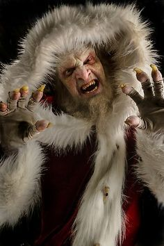 """Krampus is a hideous Wesen in a Santa outfit that exhibits a terrifying brand of """"scared straight"""" justice. With sharp teeth, curled horns, claws and a flaming red-forked tongue."""