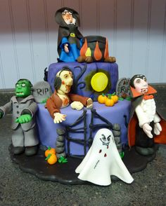 """Halloween party at the cemetery - I just finished this cake! I was so excited and concerned about it, because it is my 3rd cake, but it is my 1st stacked cake. Even though the top cake is only a 6"""", I wasn't sure I would know how to put it together. All figures are original and made of fondant and sugar paste. :) I still don't know the techniques very well, but I am trying to learn! :) Figures: a witch, a Dracula, a Frankenstein, a zombie and a brain, and a ghost."""