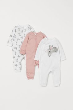 Long-sleeved, all-in-one pyjamas in soft, organic cotton jersey. Cute Girl Outfits, Kids Outfits, Best Pajamas, Baby Girl Pajamas, Pink Rabbit, Jersey, Newborn Outfits, Newborn Clothing, Cotton Pyjamas