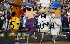 """""""This is Brewers baseball, in which a team seeking its first World Series title still has time for complete nuttiness."""" ---The Brewers sausage race, as described by the New York Times. First World Series, Get Happy, Milwaukee Brewers, Sausages, Chorizo, Ny Times, A Team, Wisconsin, Pride"""