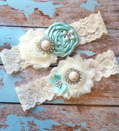 ***Includes toss and keepsake ****  2 ivory chiffon flowers with pearl and rhinestone accents make this keepsake garter so elegant - toss is
