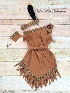 This is a great outfit to wear for Halloween, Thanksgiving, plays, pageants, and just to have fun playing Pocahontas. This dress has a one shoulder bodice. Dress fastens on the shoulder with snaps and has a sash. Dress is a tobacco brown faux suede cloth with hand cut fringe on the