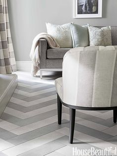 In a sitting area off the kitchen, a chevron-pattern tile floor plays off the curtains and slipper chairs.