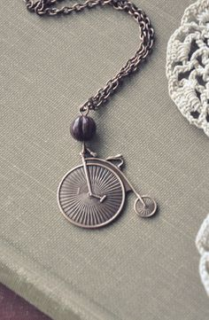 Items similar to autumn bicycle necklace. on Etsy