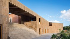 Mexican architecture firm Productora has used pigmented concrete walls, brickwork steps and timber-framed windows to construct this museum and library in Oaxaca.