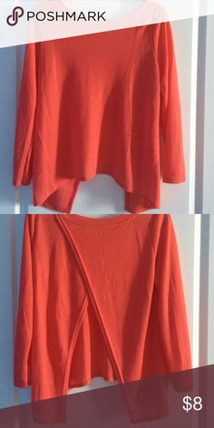 3/4 quarter sleeve with an open back top A pretty pale orange top with an adorable open back! 3/4 sleeve, never worn! Size Large Tops Blouses