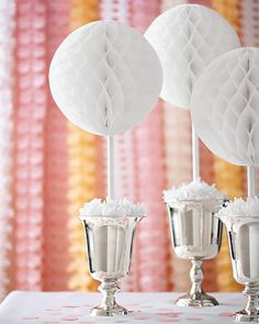 Centerpieces                                            Create this simple centerpiece by attaching a painted dowel rod -- 3/8-inch in diameter and approximately 18 inches long -- to a store-bought tissue ball, available at bulkpartysupplies.com. Stick the dowel rod in an urn, and hold it in place by packing the urn tightly with crumpled paper.