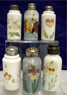Antique Glass Shakers Six Different - What a great way to display your spices in a vintage inspired kitchen. I'd use a removable label to indicate the contents (somewhere so it wont interfere with the beauty)