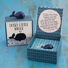 "Whale Lucky Charm - Carry a little luck with you every day! This adorable resin whale charm comes in a decorated and ready-to-give paper box with ""To/From"" on the bottom and the charm story on the inside."