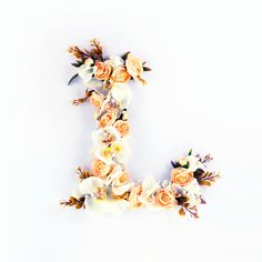 A personal favourite from my Etsy shop https://www.etsy.com/listing/481340063/floral-letter-white-orchid-flower