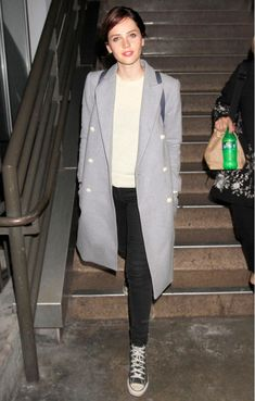 Felicity Jones wore a structured grey coat + black jeans + converse