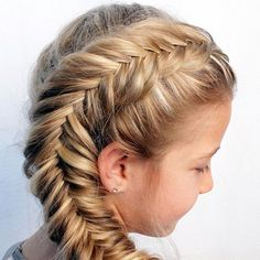 """10 Fun Summer Hairstyles for Girls **According to New York City based Milk & Cookies Spa & Salon co-owners Jataon and Teychenne Whitley, this season's hot hairstyles for little girls are all about braids. We'll give you two guesses as to why, but you're only going to need one: Elsa from """"Frozen,"""" of course! But our list also includes less time-consuming looks for little ones who won't sit still for braid creations. Read more: parenting.com:"""