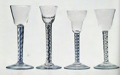A magnificent selection of color twist wine glasses, all showing rare stem features, beautifully made. The stem of the cordial second from the left is particularly splendid, and further enhanced by the moulding on the solid-based bowl.