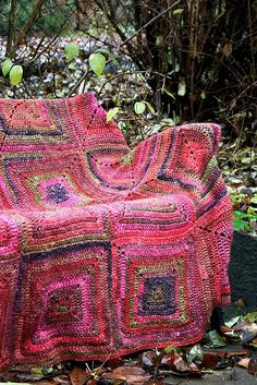 crochet throw made with 'Babette blanket' squares on Ravelry and Noro yarn.  Wish I could afford that much Noro yarn......