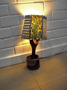 Lamp constructed of piston, graters, and circuit boards (no plans available, but really unique idea)