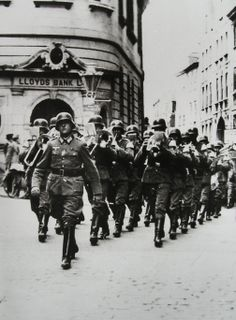 German military band marching past Lloyds bank in Guernsey