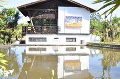Restaurante Jardim Botânico com reflexo pintura no lago