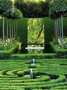 This incredibly beautiful garden uses both water and mirrors to reflect the scene in an imaginative use of trompe l'oeil
