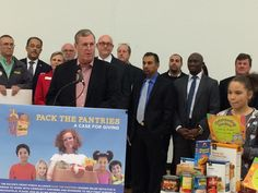 Indianapolis Mayor Greg Ballard speaking at the Pack the Pantries Indy launch, with our very own Walle waiting for his turn. #indyptp