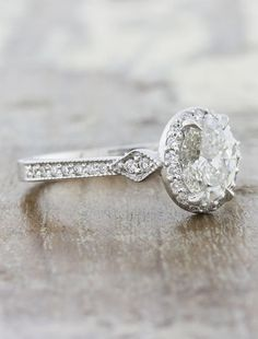 Agatha is vintage-inspired halo diamond engagement ring, with hand-crafted details that help her shine above the rest. by Ken & Dana Design.