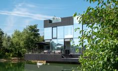 Image 2 of 20 from gallery of Villa on the Lake / Mecanoo. Photograph by Blue Sky Blue Sky Images, Advantages Of Solar Energy, Journal Du Design, Lake Pictures, Solar Water Heater, Climate Change Effects, Dark Interiors, Design Interiors, Window Design