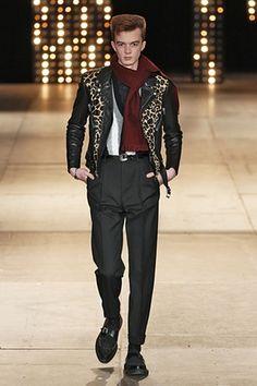 A model walks the runway at the Saint Laurent autumn/winter 2014 fashion show.